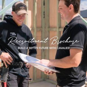 Download our franchising recruitment brochure - two builder on a work site looking at plans.